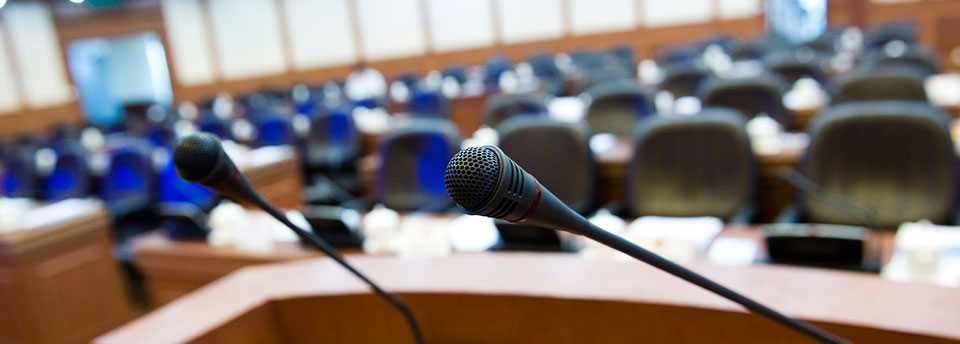 Image of council chambers with microphones